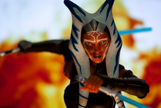 Hasbro Action figure -  Recreation of a scene from Star Wars The Clone Wars with Jedi Ahsoka Tano posed for action with her lightsabers  - NEW YORK USA - JUNE 21 2020