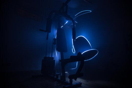 Gym equipment on dark background. Sport concept.