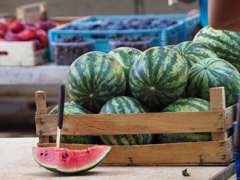 ripe farm watermelon cut for tasting at a village fair