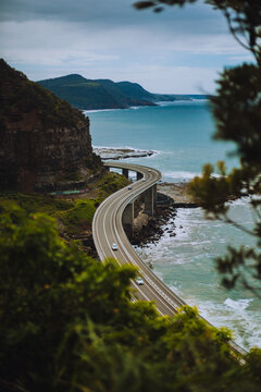 High Angle View Of Road By Sea Against Sky