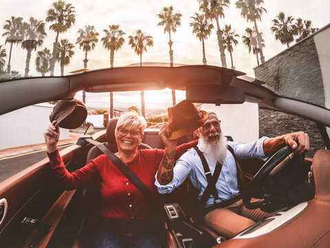 Senior Man With Woman Driving Car