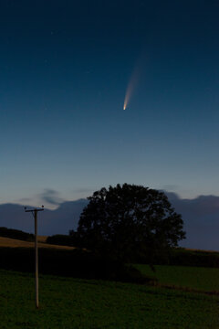 Comet C/2020 F3 (NEOWISE) shining in the early dawn sky of summer 2020, Cornwall, Uk
