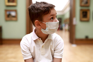 Boy wearing protection mask in art gallery