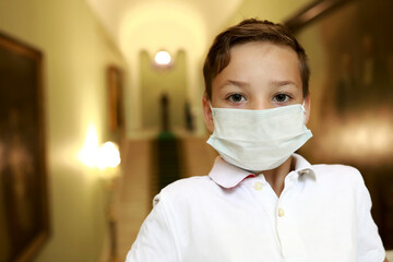 Boy wearing protection mask in museum