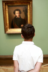 Child looking at famous portrait of Pushkin