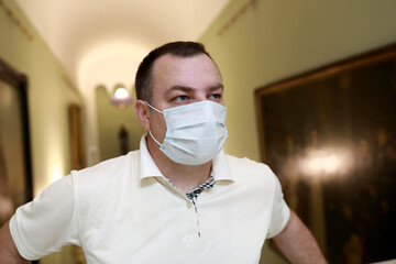 Man wearing medical protection mask in museum