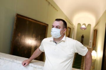 Man wearing protection mask in museum