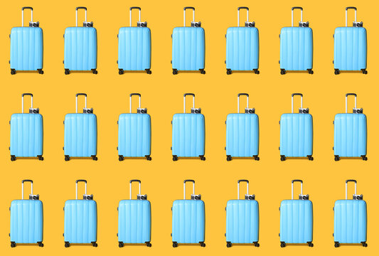 Many packed suitcases and photo cameras on color background