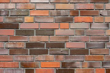 Background from a brick wall with different shades of red