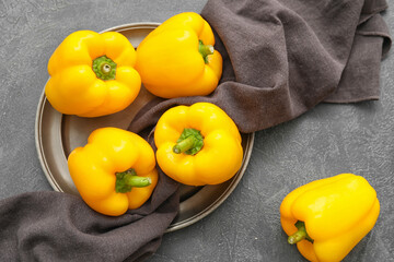 Plate with yellow bell pepper on table