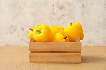 Yellow bell pepper in box on table