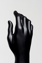 Hand of male black mannequin on a white background