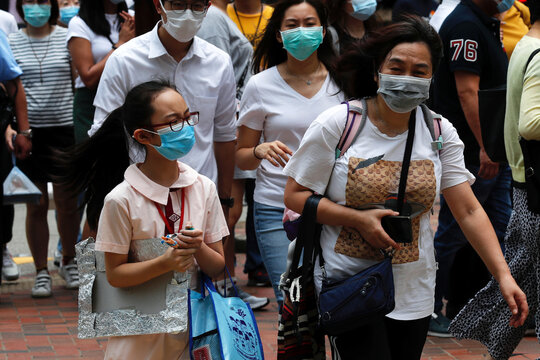 A student wears surgical mask to prevent the spread of the coronavirus disease (COVID-19), in Hong Kong