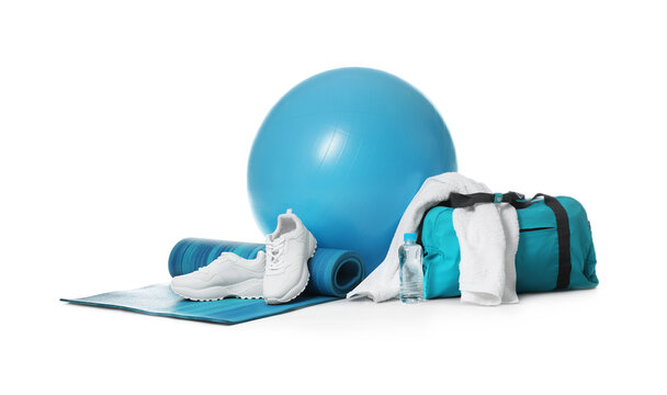 Fitness ball, gym bag and sport accessories isolated on white
