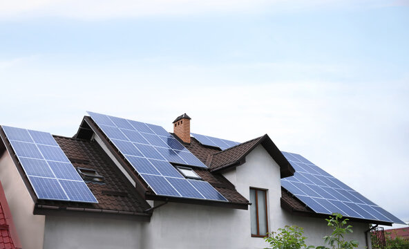 House with installed solar panels on roof. Alternative energy source