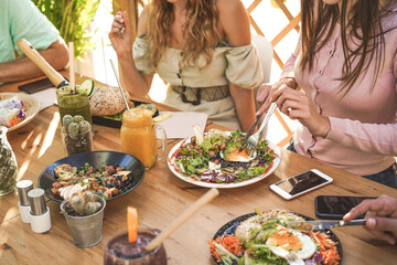 High Angle View Of Friends Having Food At Table