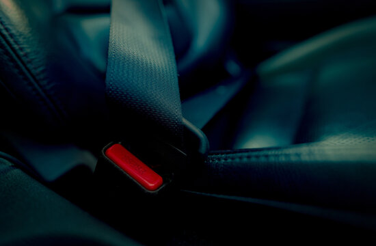 Car seat belt with red press button. Fasten seatbelt for safety and security and protect life from car accident. Buckle up black seat belt for safety. Buckle up seat belt it's the law. Safe road trip.