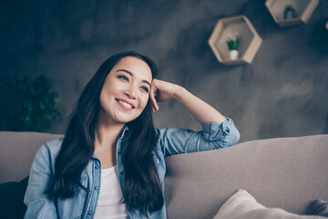 Photo of domestic pretty charming asian lady relaxing sit comfy couch staying home good mood...