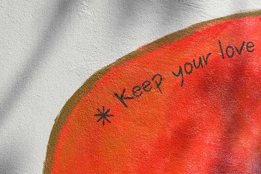 Portrait of wall with Keep Your Love message