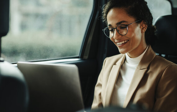 Businesswoman with laptop commuting to work