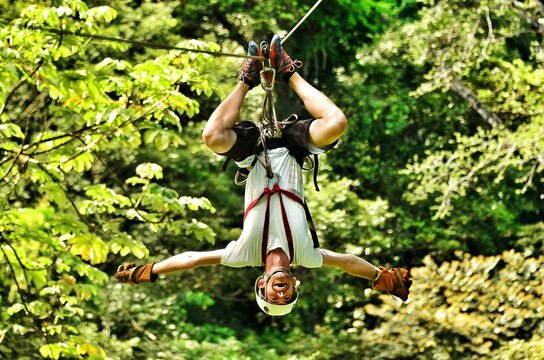 Full Length Of Young Man On Zip Line