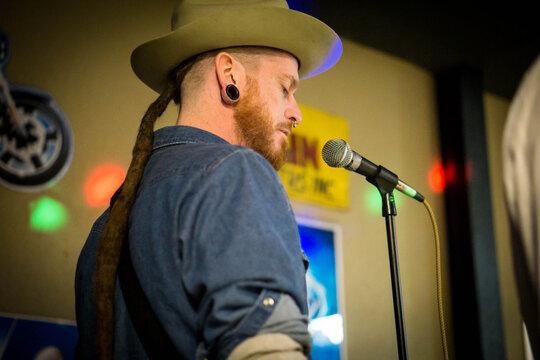 Low Angle View Of Singer Singing At Nightclub