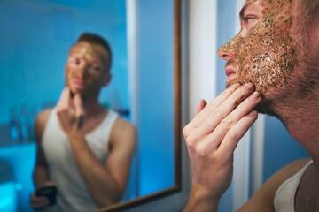 Man applying facial mask