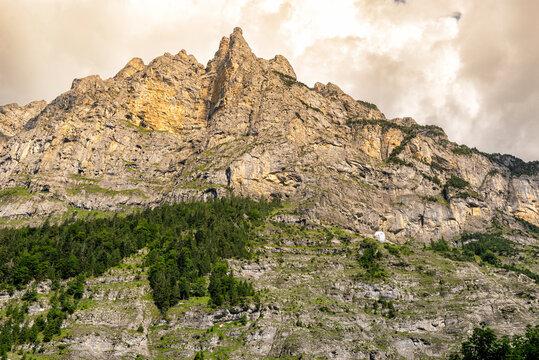 Paragliding by Jagged Alpine Rocky Cliffs