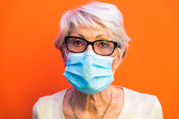 Senior woman with protection mask during covid-19 pandemic