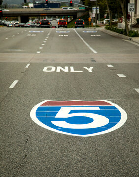 Sign for the interstate 5 freeway painted on the pavement shot from the driver's perspective