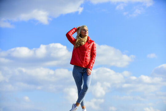 Young and beautiful. woman in model pose outdoors. feel free. woman enjoying weather outdoors. Freedom and expectation. Beauty and fashion, look. concept of loneliness. woman on blue sky background
