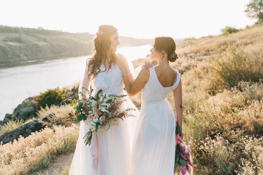 Lesbian wedding couple in white dresses