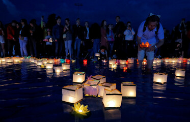 People take part in festival of water lanterns at the amusement park 'Dreamland' in Minsk