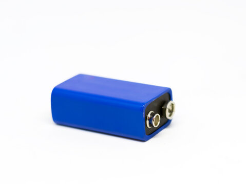 a blue 9 volt battery isolated on a white background