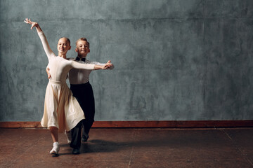 Photo Blinds Dance School Young couple boy and girl dancing in ballroom dance Viennese Waltz.