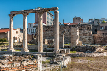 Fototapete - Library of Hadrian in Athens, Greece. It is famous tourist attraction of Athens. Scenic view of Hadrian building, classical Greek ruins,