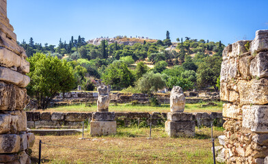 Fototapete - Ancient Agora in summer, Athens, Greece. It is famous tourist attraction of Athens. Panorama of Agora with classical Greek ruins