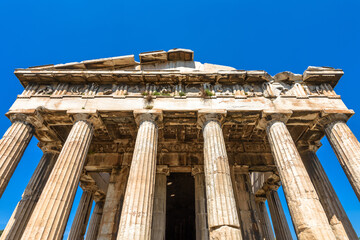 Fototapete - Temple of Hephaestus in Ancient Agora, Athens, Greece. It is famous landmarks of Athens. Front view of classical Greek temple on sky background