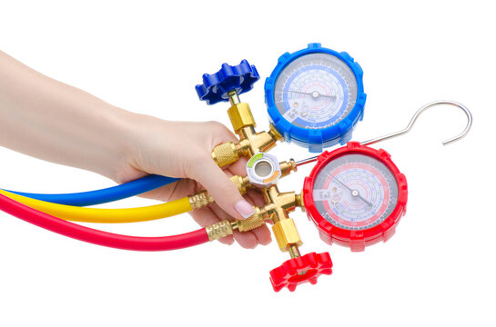 Hand holding gauge station, pressure gauge, manometer on white background isolation