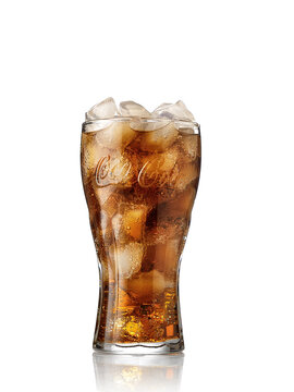 POLTAVA, UKRAINE - MARCH 22, 2019: Glass of Coca-Cola. Isolated on white Background. Coca Cola, Coke is the most popular carbonated soft drink beverages sold around the world.