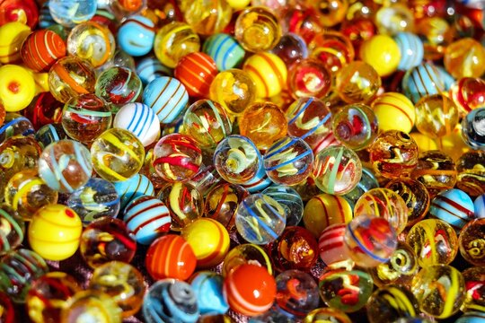 close up of colorful marbles
