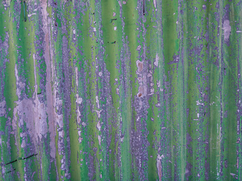 old corrugated metal panel painted green