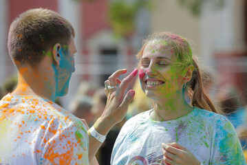 People take part in the ColorFest festival at the amusement park 'Dreamland' in Minsk