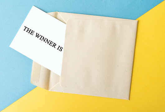 The winner is text with an envelope, competition and prize concept