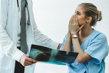 Doctor and unhappy patient at hospital or medical clinic . Healthcare medical malpractice and...