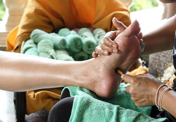 Traditional Thai foot massage with wooden stick for healthy and relax.