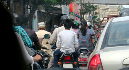 dense traffic in the streets of Hyderabad India with motorcycles and cars moving slowly Fototapete