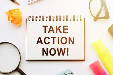 Text Take Action Now with marker, magnifier, glasses, business concept