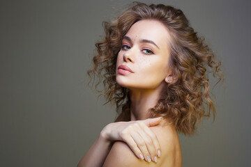 Beautiful young woman. amazing curly girl with make-up