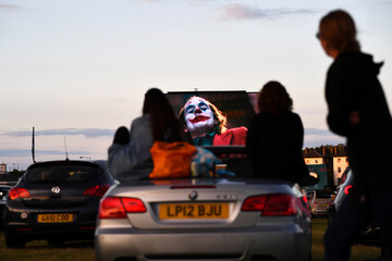 """People watch the film """"Joker"""" from their cars at a drive-in cinema in London"""